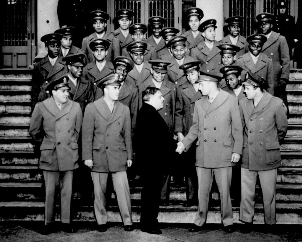 Members of the Nation's first Negro Navigation Cadets, who received their commissions into the Army Air Forces on February 26th, 1944 visited City Hall as guests of Mayor Fiorello H. La Guardia. They are shown on the steps of City Hall as the mayor greeted their commanding officer, Maj. Galen B. Price. Archive photo credits: Air Force Historical Research Agency