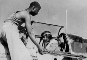Alfred Morris, crew chief of the 332nd Fighter Group of the U.S. Army Air Corps, helps his pilot, Captain William Mattison close the canopy of his P-51 Mustang fighter plane just before take-off in Italy.