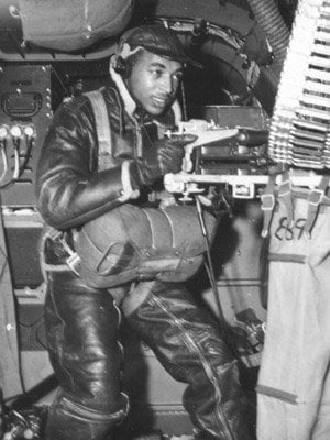 A waist gunner, crew on a B-25 bomber, trains to handle the machine gun.