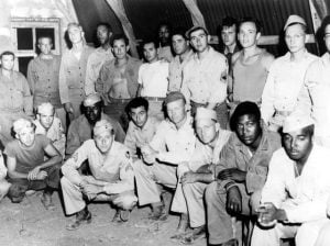 African-American and white soldiers at a base in Italy during World War II. Source United States Army