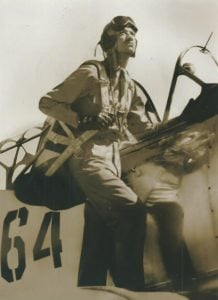 Fighter Pilot John Ellis Edwards standing on the wing of his plane