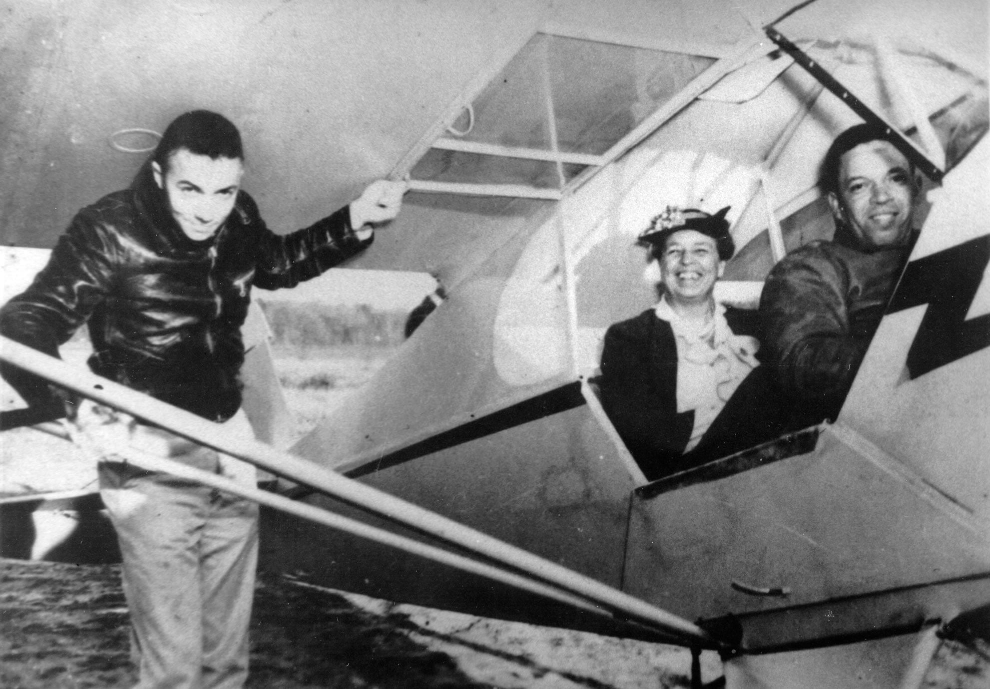 "Eleanor Roosevelt takes a ride in a Piper. Shown is Lewis Jackson, who was the Director of Training at Tuskegee. and C. Alfred ""Chief"" Anderson, who is piloting the plane."